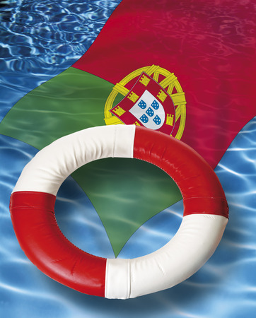 life belt: Close up of life belt with portuguese flag floating on water