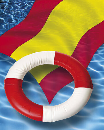 life belt: Close up of life belt with spanish flag floating on water
