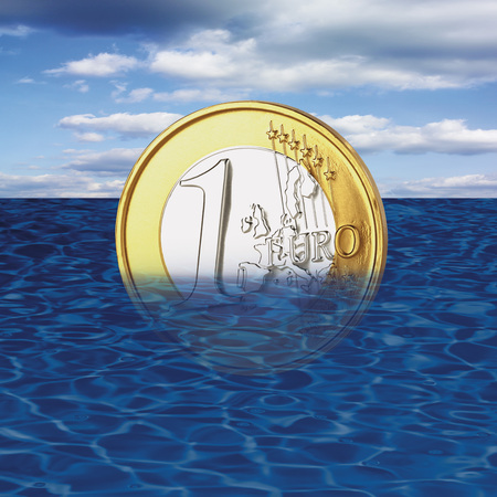 western script: One euro coin drowning in sea, close-up Stock Photo