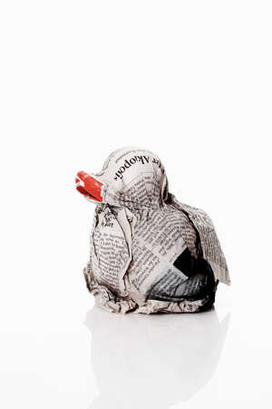 canard: Duck made from newspapers against white background