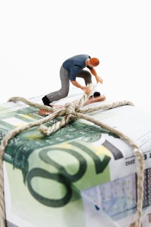 western script: Worker cording parcel of euro notes