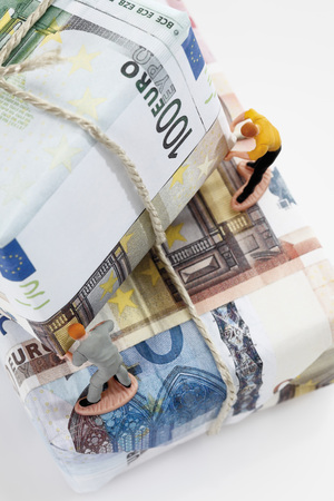 western script: Workers sorting packages of euro notes