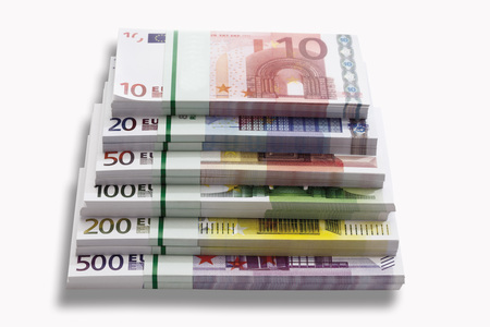 bundles: Bundles of Euro banknotes on white background, close-up