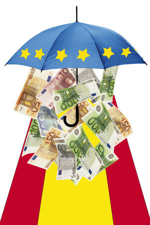 spanish flag: Euro banknotes under umbrella with spanish flag