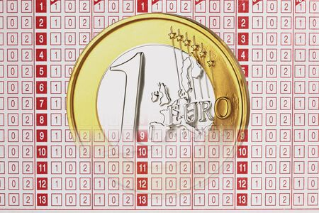 betting: Close up of 1 euro coin on betting slip Stock Photo