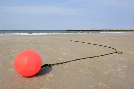 beach buoy: Germany, Schleswig-Holstein, Heligoland, North Sea, beach, buoy at low tide
