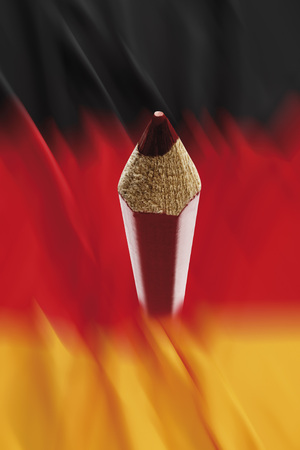 rood potlood: Close up of red pencil against german flag