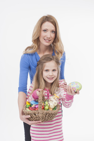 easter nest: Mother and daughter with easter egg basket, smiling, portrait