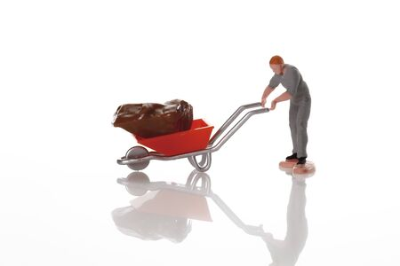 male likeness: Worker figurine with wheel barrow on white background