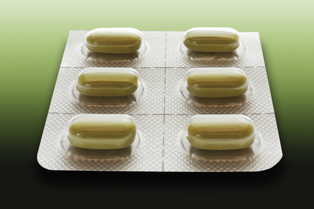 pharmaceutic: Tablets in blister pack on green background Stock Photo