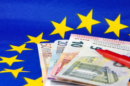 red pencil: Euro notes and red pencil, EU flag