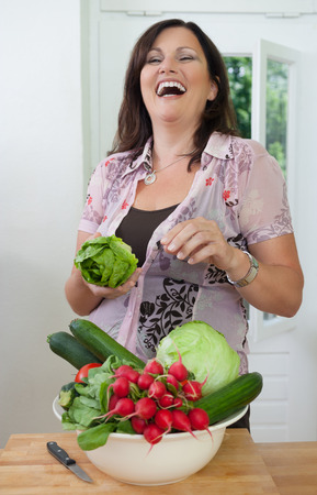 people laughing: Woman with fresh vegetables