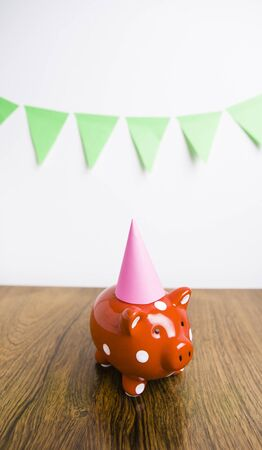 frugality: Red piggy bank having a party