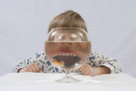 fishbowl: Girl behind fishbowl with goldfishes