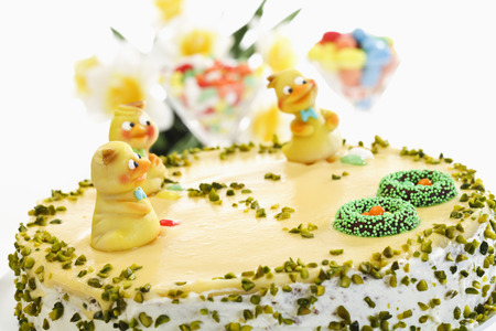 fondant fancy: Easter cake, Marzipan cake with pistachio and chick figurines Stock Photo