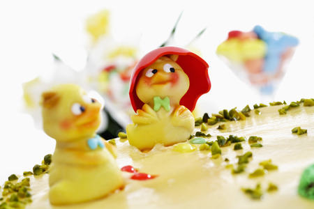 Easter cake, Marzipan cake with pistachio and chick figurines Stock Photo
