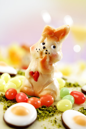 fondant fancy: Easter cake, Marzipan cake with pistachio, Easter bunny figurine and fondant