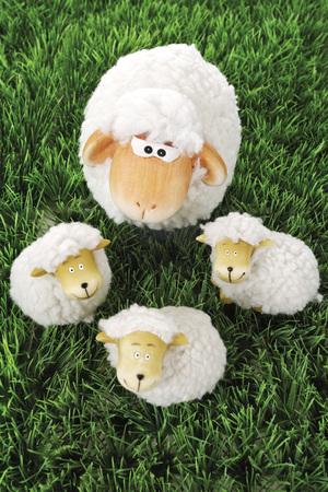 Wool sheep figurines on grass Stock Photo