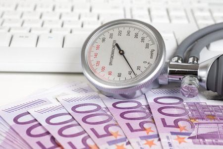 blood pressure gauge: Blood pressure gauge on 500 Euro notes
