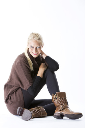 Fashion, Young woman, boots and brown pullover and black leggings