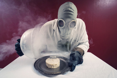stinking: Man in front of a plate with cheese under cheese cover