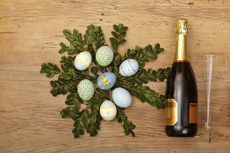 bootle: Easter decoration, champagner bootle and champagne glasses on wood