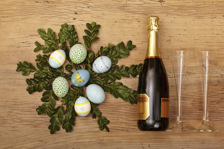 Easter decoration, champagner bootle and champagne glasses on wood
