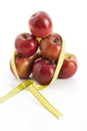 measuring tape: Apples and measuring tape Stock Photo