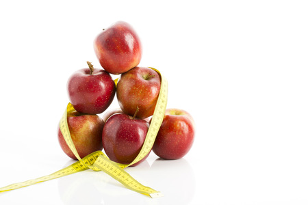 exactitude: Apples and measuring tape Stock Photo