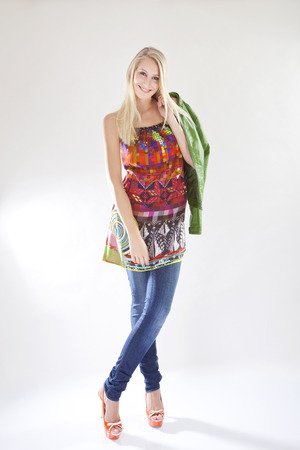 ethno: Young woman wearing jeans and colorful ethno shirt