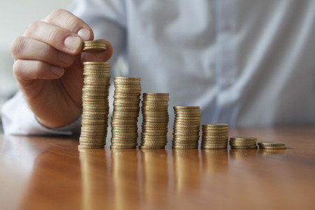 Finances, Person stacking Euro coins, close-up Stockfoto