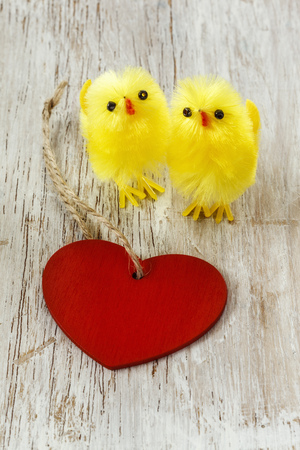 twee: Eastern, chick figurines and red heart on wood