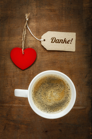valentine day cup of coffee: Coffee cup and heart on dark wood, Thank you