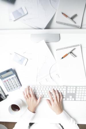 Woman working at desk, keyboard Stock fotó