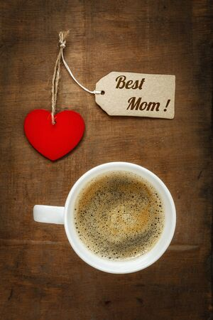 Coffee cup and heart on dark wood, Best Mom photo