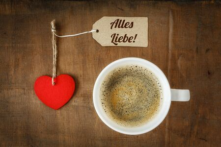 Coffee cup and heart on dark wood, Much love photo
