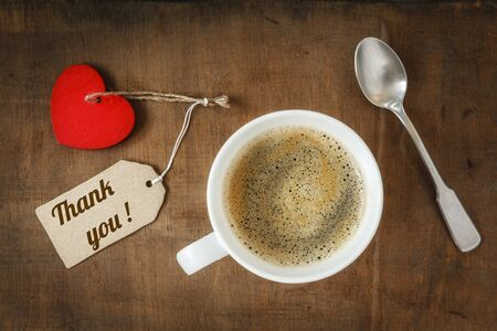 Coffee cup and heart on dark wood, Thank you photo