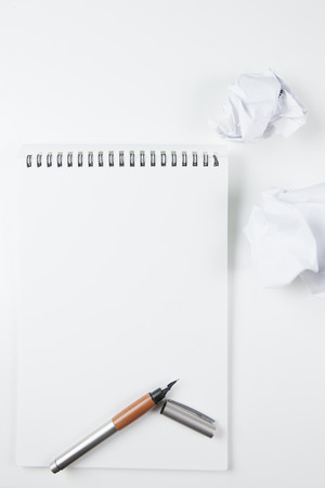 fountain pen: Fountain pen and notepad, crumpled paper balls Stock Photo