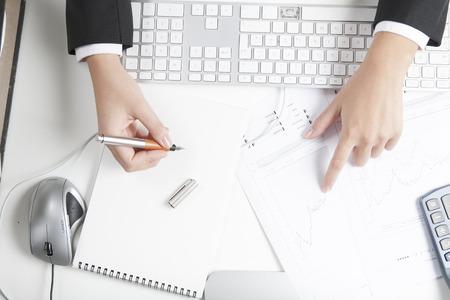 stockbroker: Stockbroker working at desk, notepad