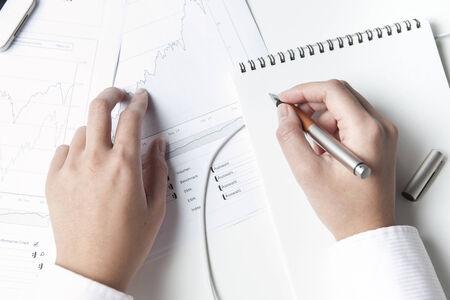 stockbroker: Stockbroker writing on notepad