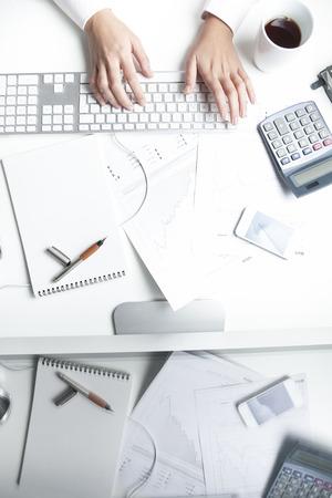 stockbroker: Stockbroker working at desk, keyboard Stock Photo