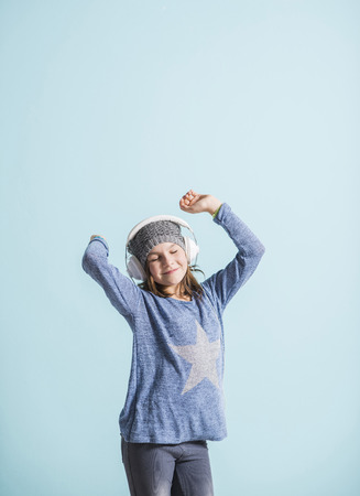 head phones: Girl with head phones dancing and listening to music