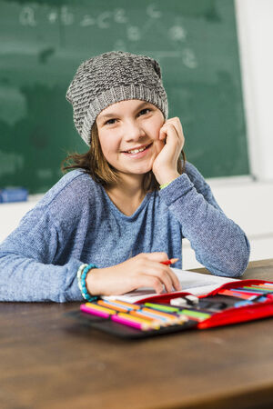 class room: Smiling girl sitting in class room