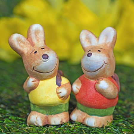leporidae: Two easter bunny figurines on meadow
