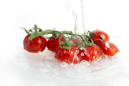 Washing cherry tomatoes photo