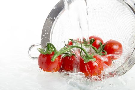 a colander: Washing cherry tomatoes, colander