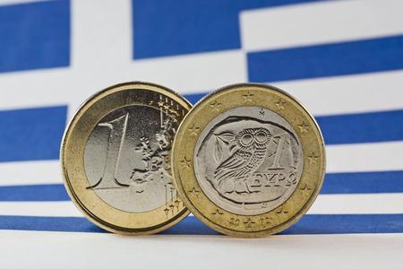 Greece: Greek 1 Euro coins, Flag of Greece Stock Photo