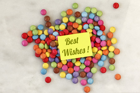 best wishes: Smarties on marble, Best wishes Stock Photo