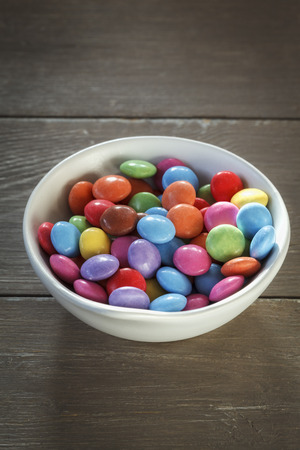 smarties: Bowl with smarties, wood