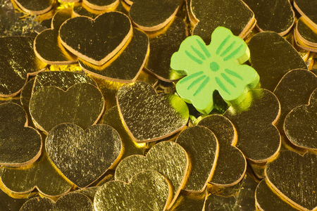 cloverleaves: Cloverleaf on golden hearts Stock Photo